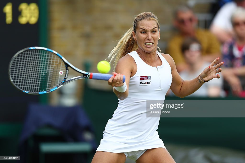 Dominika Cibulkova of Slovakia plays a forehand during the Ladies Singles first round match against Mirjana Lucic-Baroni of Croatia on day two of the Wimbledon Lawn Tennis Championships at the All England Lawn Tennis and Croquet Club on June 28, 2016 in London, England. (Photo by Julian Finney/Getty Images))
