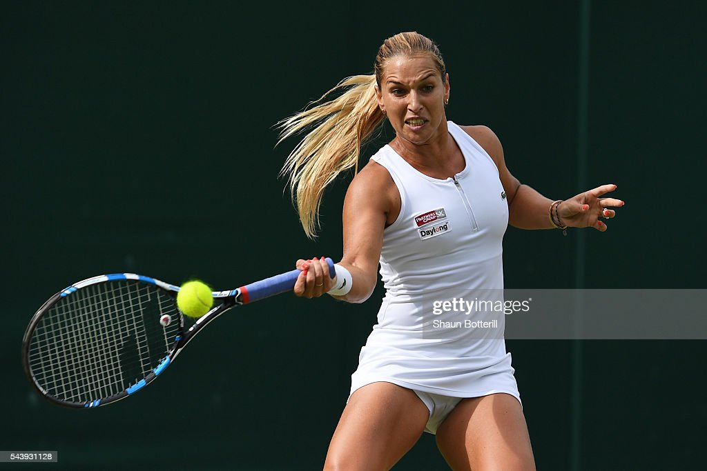 <a gi-track='captionPersonalityLinkClicked' href=/galleries/search?phrase=Dominika+Cibulkova&family=editorial&specificpeople=4091238 ng-click='$event.stopPropagation()'>Dominika Cibulkova</a> of Slovakia plays a forehand during the Ladies Singles second round match against Daria Gavrilova of Australia on day four of the Wimbledon Lawn Tennis Championships at the All England Lawn Tennis and Croquet Club on June 30, 2016 in London, England.