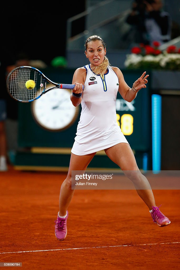 Dominika Cibulkova of Slovakia plays a forehand in her match against Louisa Chirico of USA in the semi finals during day seven of the Mutua Madrid Open tennis tournament at the Caja Magica on May 06, 2016 in Madrid, Spain.