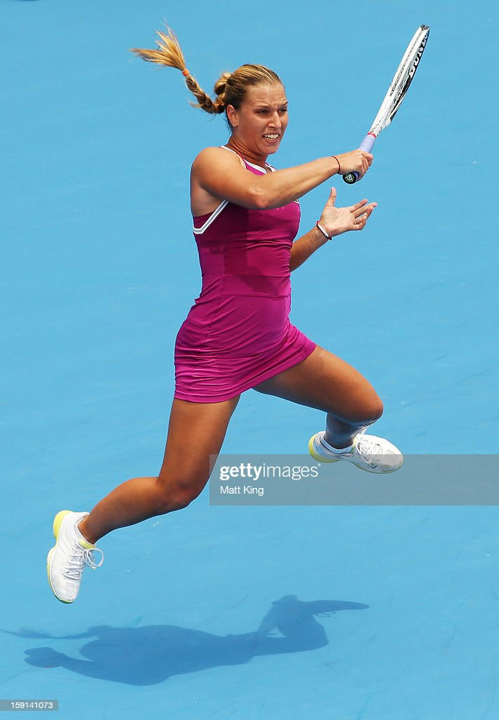 Dominika Cibulkova of Slovakia plays a forehand in her quarter final match against Sara Errani of Italy during day four of the Sydney International at Sydney Olympic Park Tennis Centre on January 9, 2013 in Sydney, Australia.