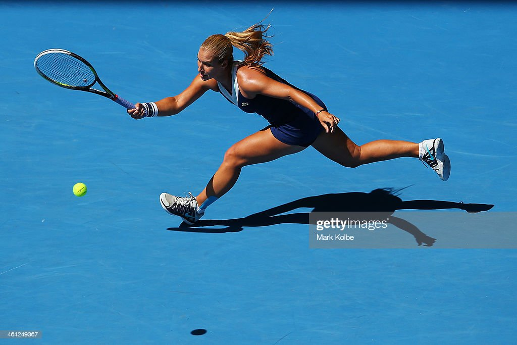 Dominika Cibulkova of Slovakia plays a forehand in her quarterfinal match against Simona Halep of Romania during day 10 of the 2014 Australian Open...