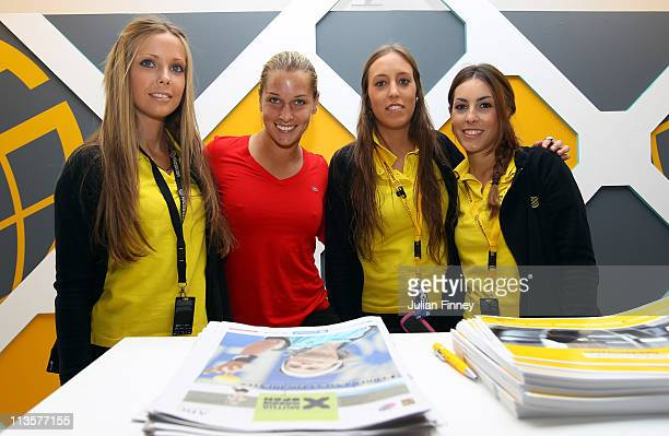 Dominika Cibulkova of Slovakia poses for a photo in the Prosegur spanish security booth during day four of the Mutua Madrilena Madrid Open Tennis on...