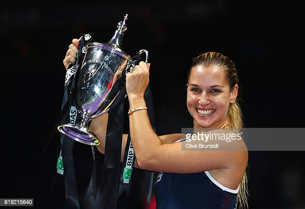 Dominika Cibulkova of Slovakia poses with the trophy after victory in her singles final against Angelique Kerber of Germany during day 8 of the BNP...
