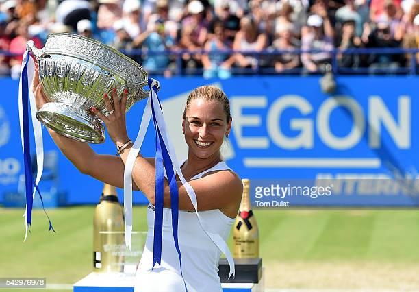 Dominika Cibulkova of Slovakia poses with the trophy after winning the final match against Karolina Pliskova of Czech Republic on day seven of the...