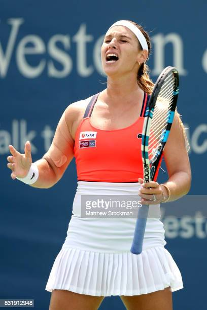 Dominika Cibulkova of Slovakia reacts to a lost point against Ana Konjuh of Croatia during day 4 of the Western Southern Open at the Lindner Family...