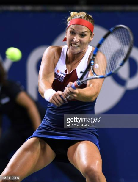 Dominika Cibulkova of Slovakia returns a shot to Caroline Wozniacki of Denmark during their women's singles quarterfinal match at the Pan Pacific...