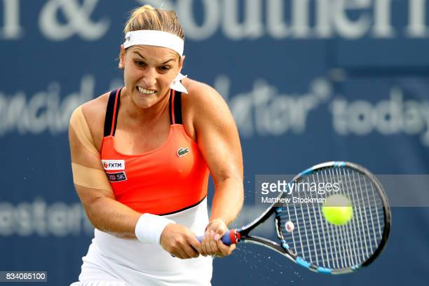 Dominika Cibulkova of Slovakia returns a shot to Johanna Konta of Great Britain during day 6 of the Western Southern Open at the Lindner Family...
