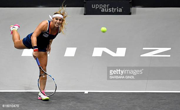 Dominika Cibulkova of Slovakia returns the ball to Viktorija Golubic of Switzerland during the final match at the WTA Ladies Tennis Tournament in...
