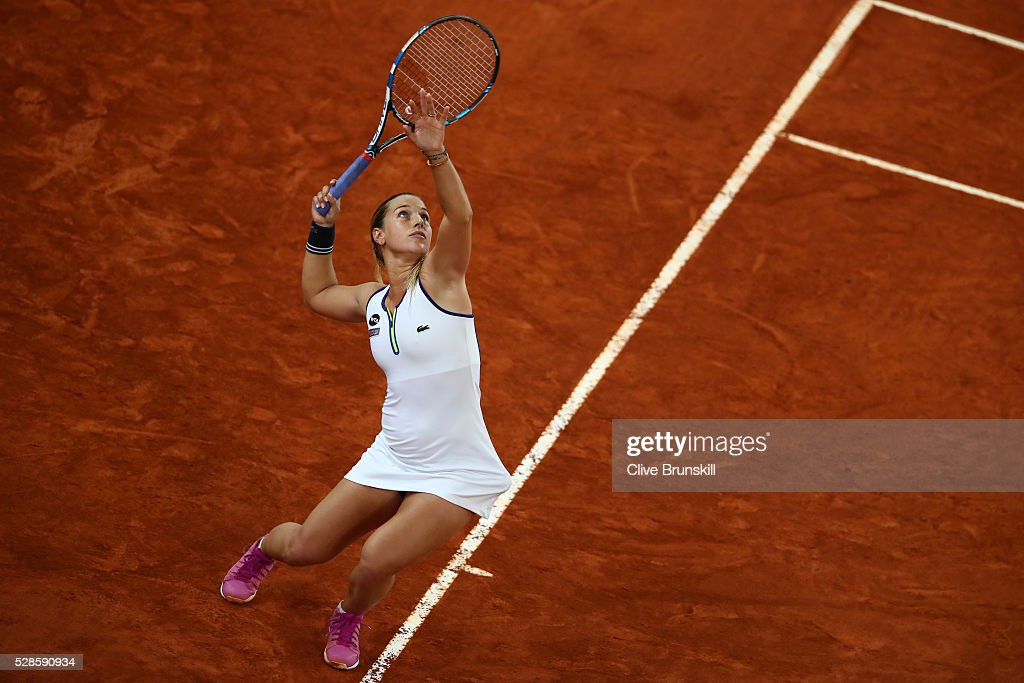 <a gi-track='captionPersonalityLinkClicked' href=/galleries/search?phrase=Dominika+Cibulkova&family=editorial&specificpeople=4091238 ng-click='$event.stopPropagation()'>Dominika Cibulkova</a> of Slovakia serves against Louisa Chirico of the United States in their semi final match during day seven of the Mutua Madrid Open tennis tournament at the Caja Magica on May 06, 2016 in Madrid,Spain.