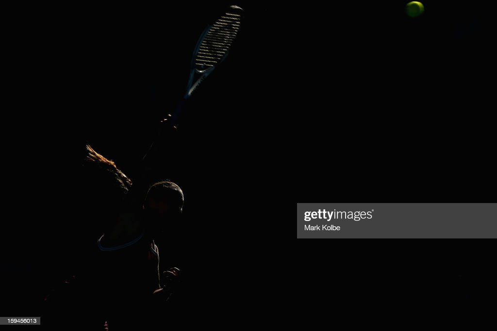 Dominika Cibulkova of Slovakia serves in her first round match against Ashleigh Barty of Australia during day one of the 2013 Australian Open at Melbourne Park on January 14, 2013 in Melbourne, Australia.