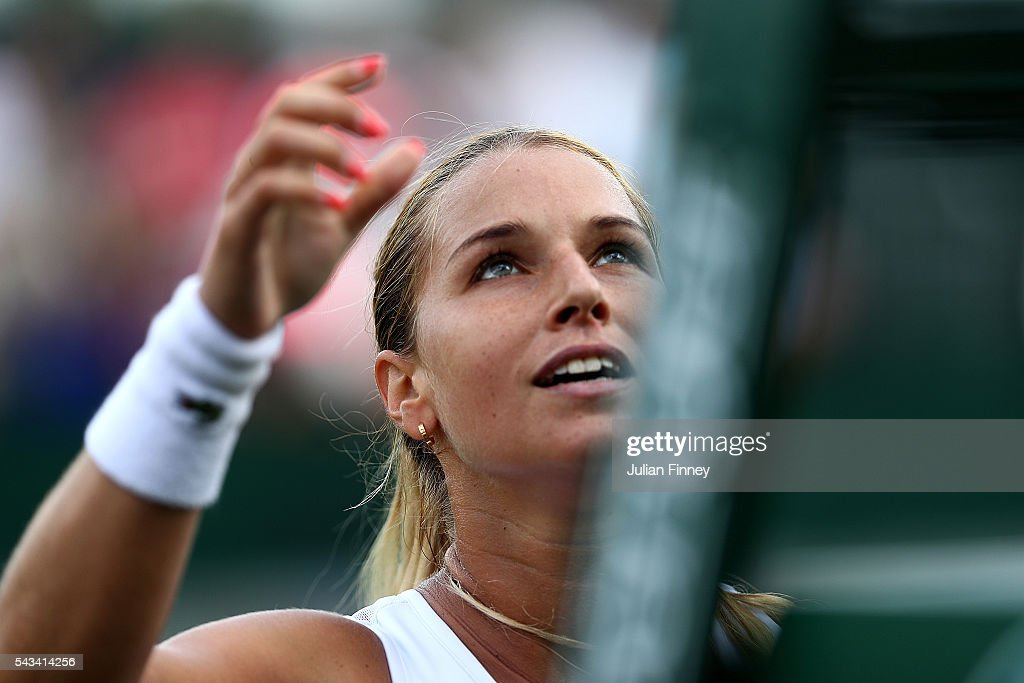 <a gi-track='captionPersonalityLinkClicked' href=/galleries/search?phrase=Dominika+Cibulkova&family=editorial&specificpeople=4091238 ng-click='$event.stopPropagation()'>Dominika Cibulkova</a> of Slovakia shakes hands with the umpire following victory during the Ladies Singles first round match against Mirjana Lucic-Baroni of Croatia on day two of the Wimbledon Lawn Tennis Championships at the All England Lawn Tennis and Croquet Club on June 28, 2016 in London, England.