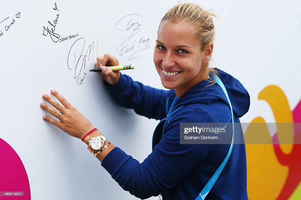 Dominika Cibulkova of Slovakia signs her autograph at the MLC Autograph Island during day 6 of the 2014 Australian Open at Melbourne Park on January...