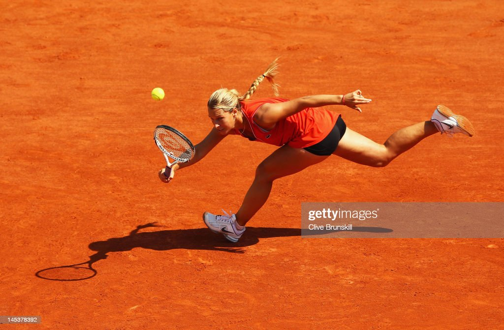 Dominika Cibulkova of Slovakia stretches to hit a forehand in the women's singles first round match between Kristina Mladenovic of France and Dominika Cibulkova of Slovakia during day two of the French Open at Roland Garros on May 28, 2012 in Paris, France.