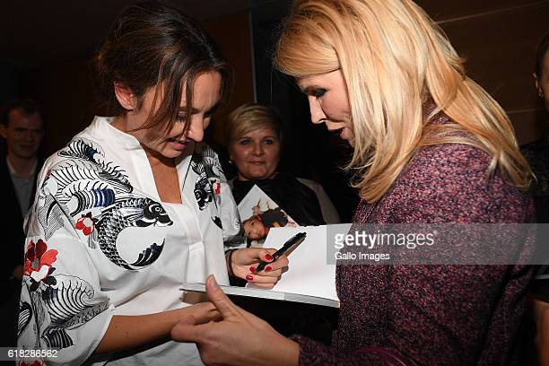 Dominika Kulczyk gives an autograph to Anna Jurksztowicz during the promotion of her book Efekt domina on October 20 2016 in Warsaw Poland Kulczyk is...