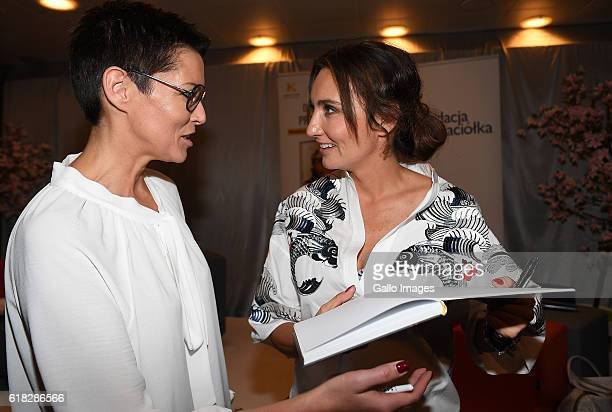 Dominika Kulczyk gives an autograph to Ilona Felicjanska during the promotion of her book Efekt domina on October 20 2016 in Warsaw Poland Kulczyk is...