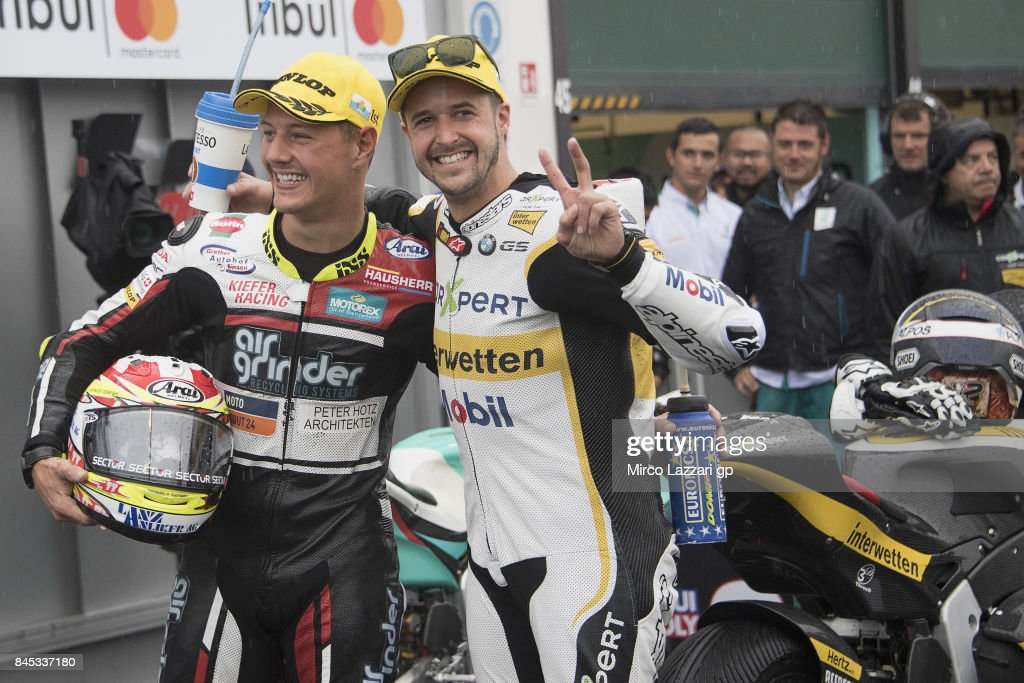 Dominique Aegerter of Switzerland and Kiefer Racing and Thomas Luthi of Switzerland and Carxpert Interwetten (R) celebrate under the podium at the end of the Moto2 Race during the MotoGP of San Marino - Race at Misano World Circuit on September 10, 2017 in Misano Adriatico, Italy.