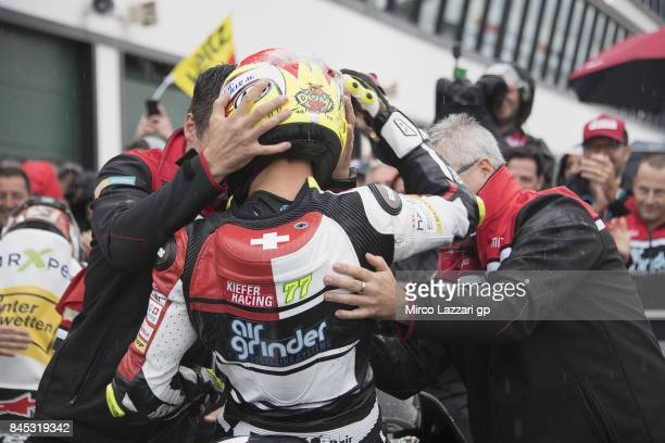 Dominique Aegerter of Switzerland and Kiefer Racing celebrates the victory with team under the podium at the end of the Moto2 Race during the MotoGP...