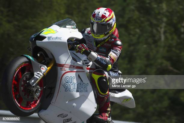 Dominique Aegerter of Switzerland and Kiefer Racing lifts the front wheel during the MotoGp of Czech Republic Qualifying at Brno Circuit on August 5...