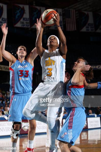 Dominique Canty of the Chicago Sky goes to the basket past Alison Bales and Coco Miller of the Atlanta Dream during the WNBA game on August 23 2011...