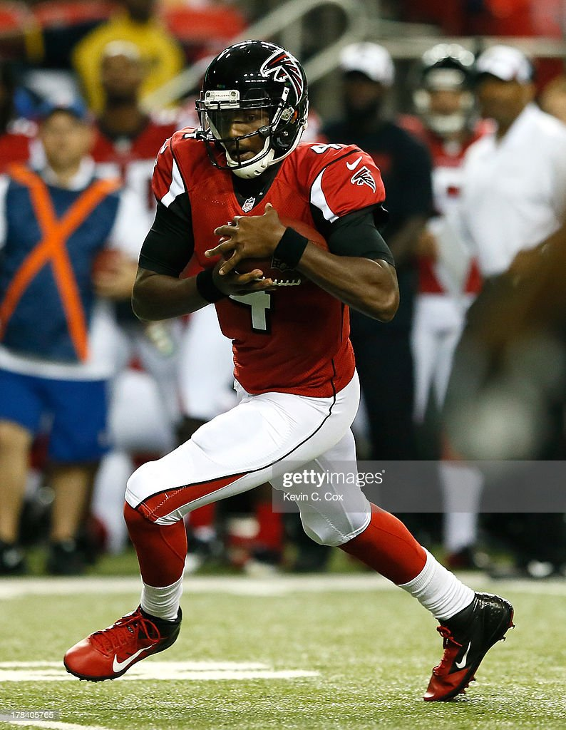 <a gi-track='captionPersonalityLinkClicked' href=/galleries/search?phrase=Dominique+Davis&family=editorial&specificpeople=5534461 ng-click='$event.stopPropagation()'>Dominique Davis</a> #4 of the Atlanta Falcons rushes upfield against the Jacksonville Jaguars at Georgia Dome on August 29, 2013 in Atlanta, Georgia.