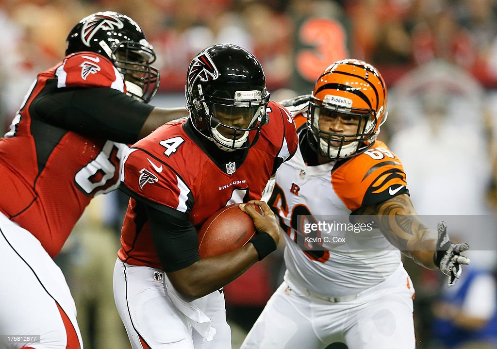 <a gi-track='captionPersonalityLinkClicked' href=/galleries/search?phrase=Dominique+Davis&family=editorial&specificpeople=5534461 ng-click='$event.stopPropagation()'>Dominique Davis</a> #4 of the Atlanta Falcons rushes upfield away from DeQuin Evans #69 of the Cincinnati Bengals at Georgia Dome on August 8, 2013 in Atlanta, Georgia.
