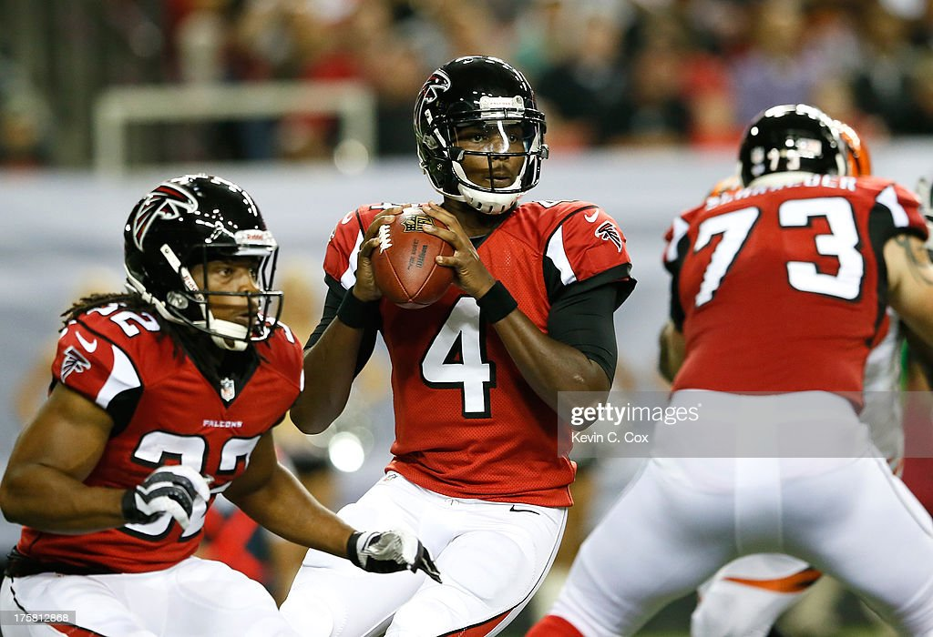 <a gi-track='captionPersonalityLinkClicked' href=/galleries/search?phrase=Dominique+Davis&family=editorial&specificpeople=5534461 ng-click='$event.stopPropagation()'>Dominique Davis</a> #4 of the Atlanta Falcons steps back in the pocket against the Cincinnati Bengals at Georgia Dome on August 8, 2013 in Atlanta, Georgia.