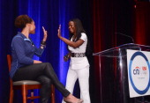 Dominique Dawes and Kari Miller clap hands at an event to celebrate Citi's Team USA sponsorship and mark its 200th anniversary at the Hyatt Regency...