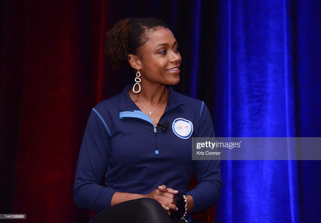 Dominique Dawes listens during an event to celebrate Citi's Team USA sponsorship and mark its 200th anniversary at the Hyatt Regency Washington on...