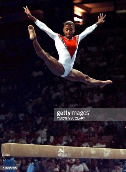 Dominique Dawes performs on the balance beam during the finals of the Women's Optionals at the 1996 US Olympic Gymnastic Team Trials at the Fleet...