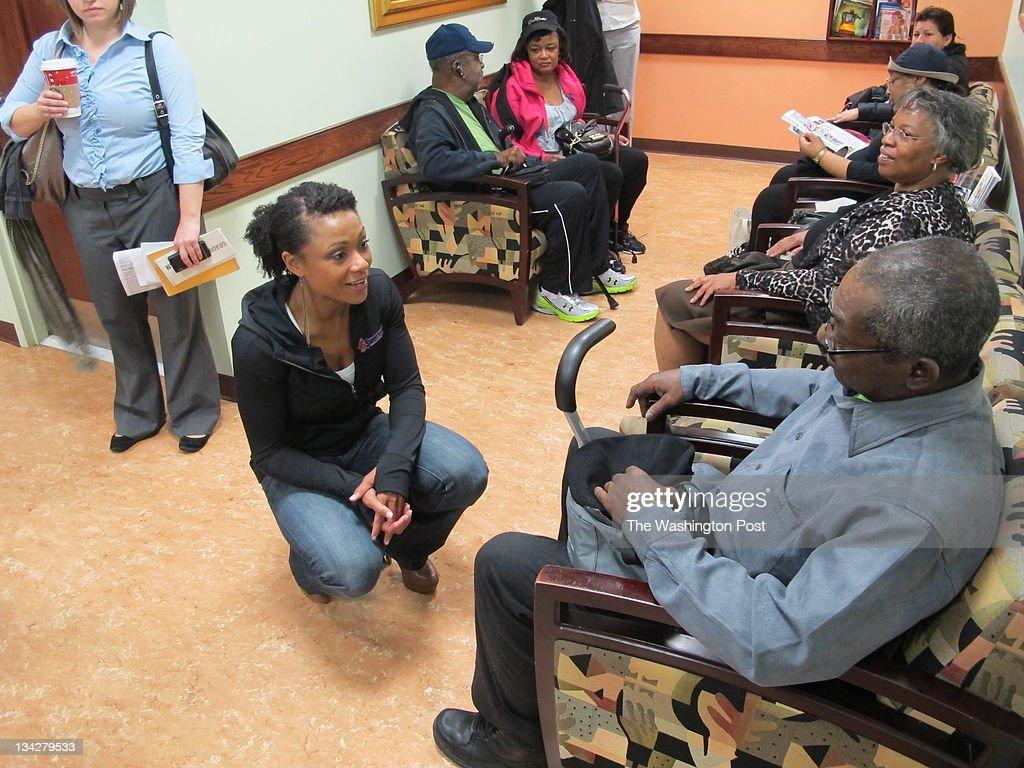 Dominique Dawes talks with patients at the Howard University diabetes treatment center.