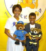Dominique Dawes with a BuildABear Worshop Bear and Marc John Jeffries with a BuildABear Worshop Bear