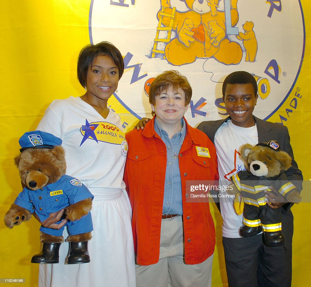 Dominique Dawes with a BuildABear Worshop Bear Maxine Clark and Marc John Jeffries with a BuildABear Worshop Bear