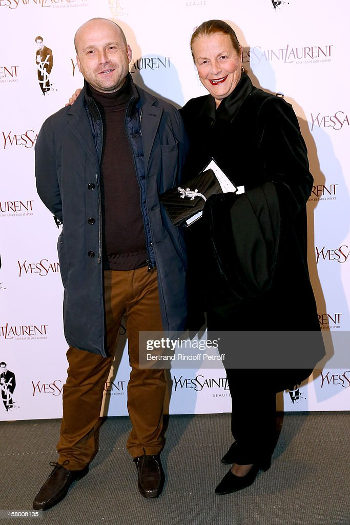 Dominique de Roche (R) and Guest attend the 'Yves Saint Laurent' Paris movie Premiere at Cinema UGC Normandie on December 19, 2013 in Paris, France.