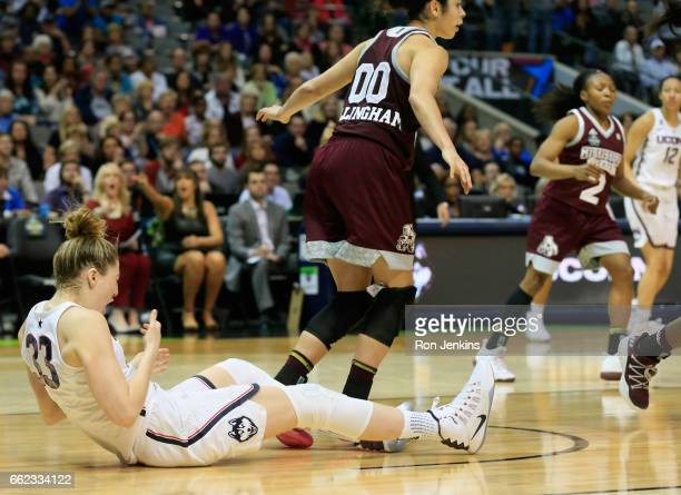 Dominique Dillingham of the Mississippi State Lady Bulldogs flagrantly flouls Katie Lou Samuelson of the Connecticut Huskies in the overtime during...