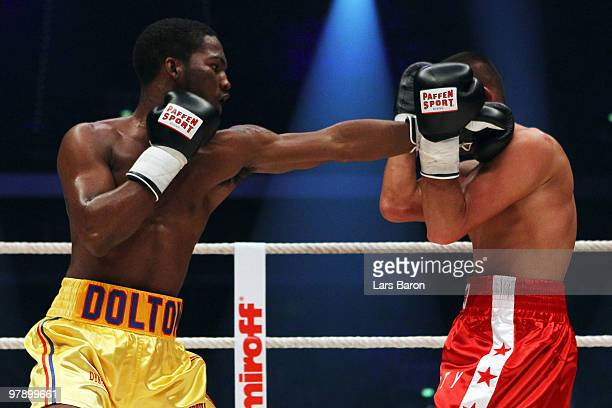 Dominique Dolton of USA lands a punch on Omar Siala of Germany during their 4 Rounds Light Middleweight fight prior to the WBO Heavyweight World...