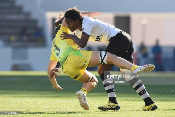 Dominique Du Toit of Australia is tackled by Pricilla Sauvavi Siata of Fiji during the HSBC World Rugby Women's Sevens Series 2016/17 Kitakyushu...