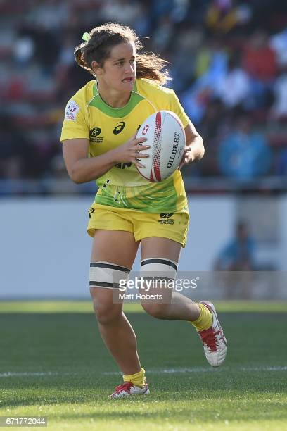 Dominique Du Toit of Australia looks to pass the ball during the HSBC World Rugby Women's Sevens Series 2016/17 Kitakyushu bronze final between...