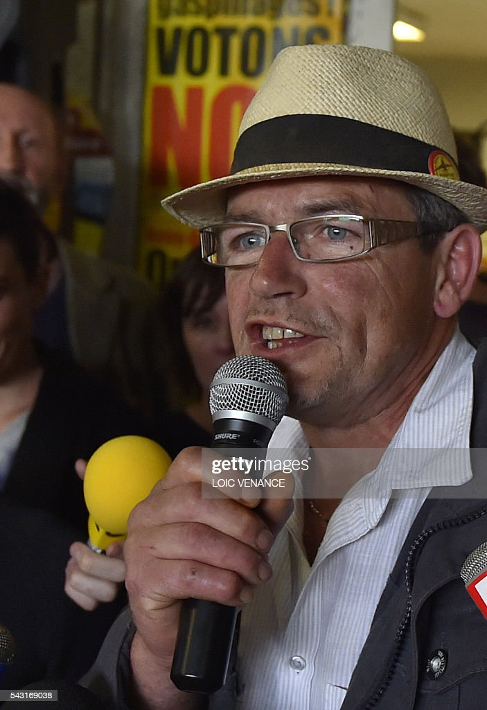 Dominique Fresneau, anti-airport association ACIPA co president, gives a speech after the results at the Vache rit farm after a local referendum organised in Loire Atlantique to transfer of the Nantes Atlantique airport to Notre-Dame-des-Landes, in Notre-Dame-des-Landes, on June 26, 2016. Nearly one million people living in France's Loire-Atlantique department voted in a referendum which poses the question 'Are you in favour of the project to transfer the Nantes-Atlantique airport to the municipality of Notre-Dame-des-Landes?' to voters. The referendum was organised by the French executive power hoping to find a solution to the issue which has dragged on for 50 years. / AFP / LOIC