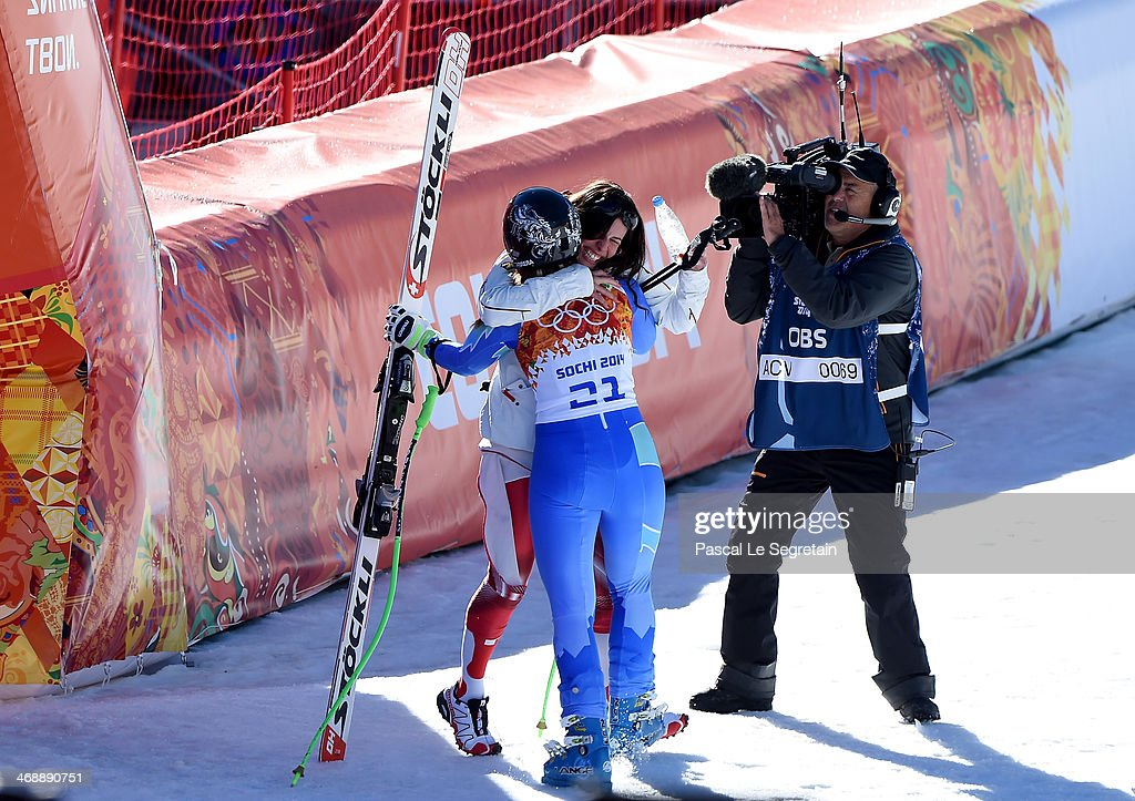 Dominique Gisin of Switzerland hugs Tina Maze of Slovenia after her run during the Alpine Skiing Women's Downhill on day 5 of the Sochi 2014 Winter...