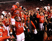 Dominique Hatfield of the Utah Utes on the shoulder of teammate Isaac Asiata of the Utah Utes leads the team in celebration after their 3024 win of...