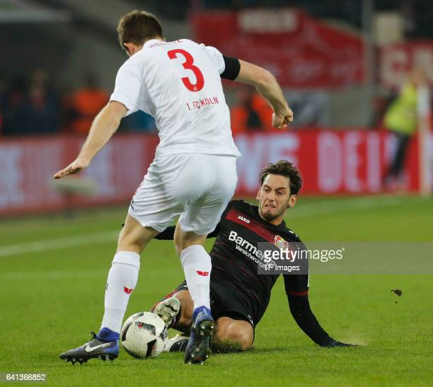 Dominique Heintz of Cologne and Hakan Calhanoglu of Leverkusen battle for the ball during the Bundesliga soccer match between 1 FC Cologne and Bayer...