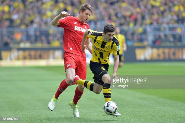Dominique Heintz of Colonge and Christian Pulisic of Dortmund battle for the ball during the Bundesliga match between Borussia Dortmund and FC Koeln...