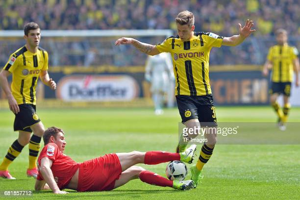 Dominique Heintz of Colonge and Erik Durm of Dortmund battle for the ball during the Bundesliga match between Borussia Dortmund and FC Koeln at...