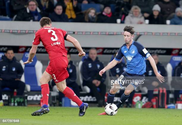 Dominique Heintz of FC Koeln and Mark Uth of Hoffenheim battle for the ball during the Bundesliga match between TSG 1899 Hoffenheim and 1 FC Koeln at...