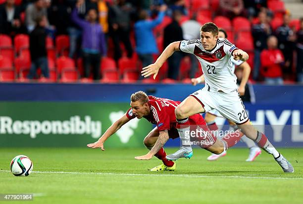 Dominique Heintz of Germany and Nicolai Brock Madsen of Denmark battle for the ball during the UEFA European Under21 Group A match between Germany...