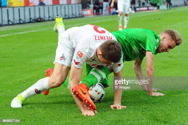 Dominique Heintz of Koeln and Nico Elvedi of Moenchengladbach battle for the ball during the Bundesliga Match between 1FC Koeln and Borussia...