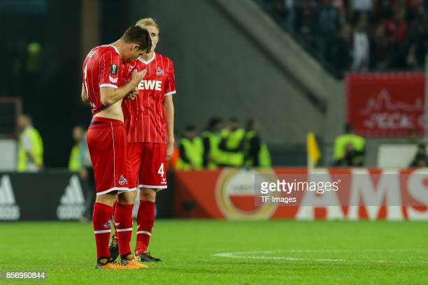 Dominique Heintz of Koeln Frederik Hillesborg Sorensen of Koeln looks dejected during the UEFA Europa League group H match between 1 FC Koeln and...