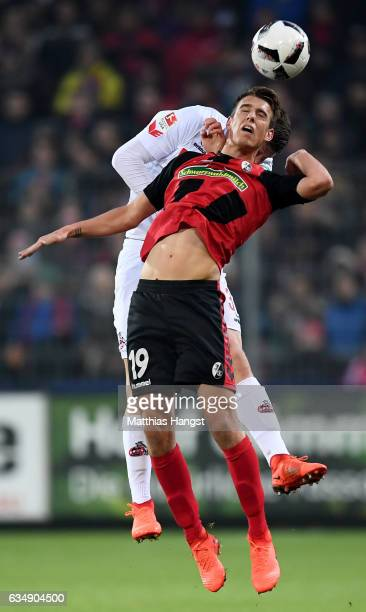 Dominique Heinz of Koeln goes up for a header with Janik Haberer of Freiburg during the Bundesliga match between SC Freiburg and 1 FC Koeln at...