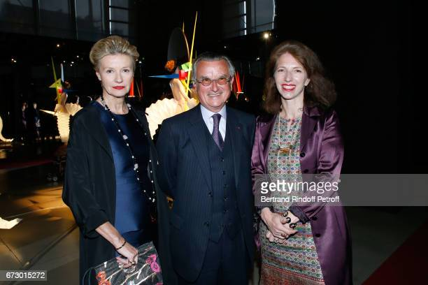 Dominique Hirsch her husband Georges Francois Hirsch and MarieChristine Labourdette pose in front the works of JeanPaul Goude during the 'Societe des...