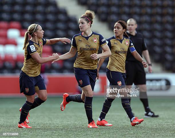 Dominique Janssen of Arsenal Ladies FC celebrates with teammate Jordan Nobbs after she scores the first goal of the game for her side from a free...